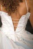 Dressing bride Stock Images