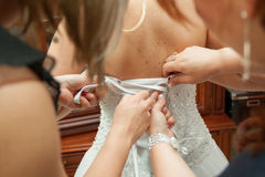 Dressing the bride dresses Stock Photos