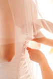 Dressing the bride dresses. Many hands holding on to each other in a group Stock Photography
