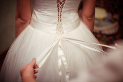 Dressing the bride dresses royalty free stock image