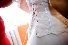 Dressing the bride's wedding dress Royalty Free Stock Images