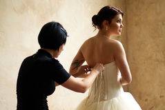 Dressing the bride with tattoo Royalty Free Stock Images