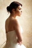Dressing the bride with tattoo Stock Photography