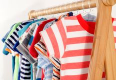 Dressing closet with clothes arranged on hangers. royalty free stock photo