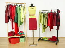Dressing closet with complementary colors red and green clothes. Royalty Free Stock Image