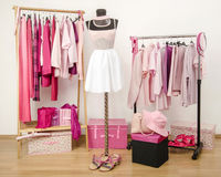 Dressing closet with pink clothes arranged on hang Royalty Free Stock Image
