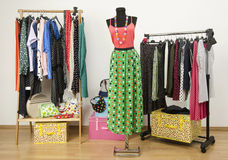Dressing closet with polka dots clothes arranged on hangers. Stock Photography