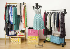 Dressing closet with polka dots clothes arranged on hangers and an outfit on a mannequin. Royalty Free Stock Photo