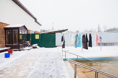 Dressing gownes and towels hang on a hanger in  winter Royalty Free Stock Images