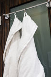 Dressing gowns for guests on the door Stock Photography