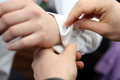 Dressing the Groom Royalty Free Stock Photo