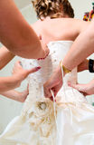 Dressing her before wedding Stock Photos