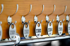 Dressing number plates hang on hook Royalty Free Stock Photo