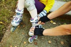 Dressing roller skates Stock Image