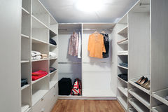 Dressing room. Modern dressing room, storage for clothing Stock Photography