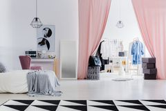 Dressing room with pink curtains. Connected with white bedroom royalty free stock photos