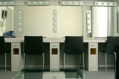Dressing Room in a Theater. Dressing room backstage at a theater, including lighted mirrors and multiple makeup stations to accommodate four people at once Royalty Free Stock Photography