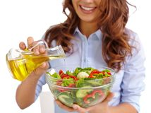 Dressing salad with olive oil Royalty Free Stock Photos