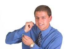 Dressing and smiling. Business man dressing and smiling Royalty Free Stock Photos