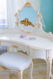 Dressing table. White dressing table in a modern bedroom royalty free stock image