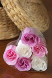 Dressing table. Wicker casket and bathroom soap as roses on wood dressing table. Selective focus at roses Stock Image