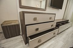 Dressing table chest of drawers in apartment bedroom stock photos
