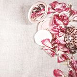 Dressing table. Comb. Powder box on the table. Table decorated with flower petals royalty free stock photography