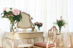 Dressing table with flowers. Old dressing table decorated with flowers and chair stock images