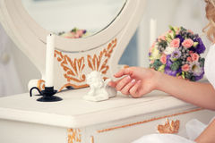 Dressing table for girl and a figure of an angel Stock Images