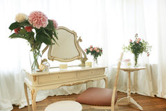 Dressing table. Old dressing table decorated with flowers and chair Royalty Free Stock Image