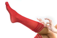 Dressing up. With sexy red socks Royalty Free Stock Photos