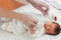 Dressing up a baby Stock Photo