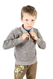 Dressing up boy. Portrait of a dressing up boy on white isolated background Stock Photos