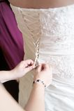 Dressing up the Bride Royalty Free Stock Photos