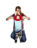 Dressing up the toddler. Young caucasian mother dressing up her little boy, isolated on white background royalty free stock image