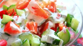 Dressing vegetable salad with sour cream and a stock footage