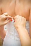 Dressing the wedding dress Royalty Free Stock Photos