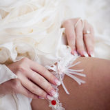 Dressing wedding garter Stock Image