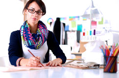 Dressmaker designing clothes pattern on paper Royalty Free Stock Photo