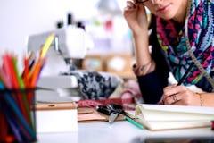 Dressmaker designing clothes pattern on paper Stock Photos
