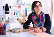 Dressmaker designing clothes pattern on paper Stock Photo