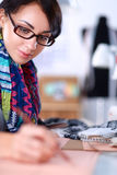 Dressmaker designing clothes pattern on paper Royalty Free Stock Image