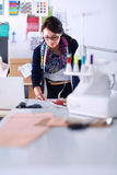 Dressmaker designing clothes pattern on paper Stock Photography