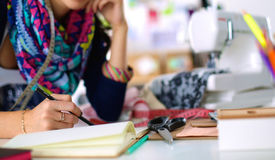 Dressmaker designing clothes pattern on paper Royalty Free Stock Photography