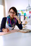 Dressmaker designing clothes pattern on paper Royalty Free Stock Photos