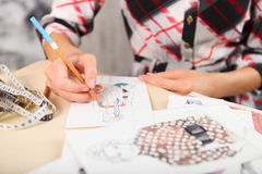 Dressmaker is drawing a fashion sketch Stock Photo
