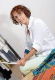 Dressmaker look at a digital tablet Royalty Free Stock Photo