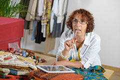 Dressmaker look at a digital tablet Stock Photos