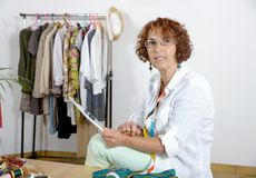 Dressmaker look at a digital tablet Royalty Free Stock Images