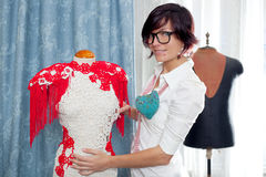 Dressmaker with mannequin working at home Stock Image